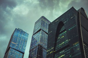 tall skyscrappers close up against cloudy stormy sky