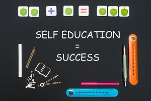 Above stationery supplies and text self education success on blackboard