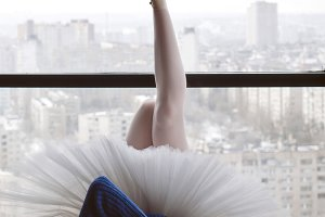 Ballerina in wool sweater and tutu
