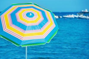 Colorful umbrella on a beach