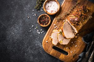 Roast pork meat with spices and herbs.  Top view.
