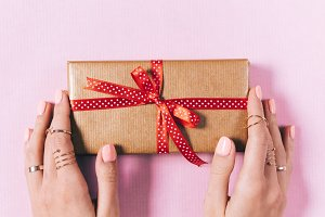 Female hands and a gift box