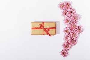Gift box in golden wrapping paper