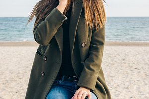 Young pretty girl in green coat