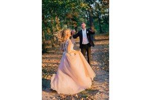 happy bride running to meet her groom