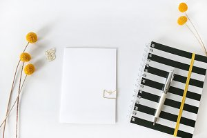 Wide notebook and note card.