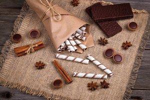 Sweet wafers rolls, caramel candies