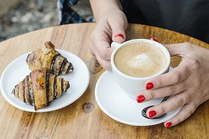 Woman hands with cup of coffee