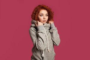 Pretty redhead curly girl dressed hoodie