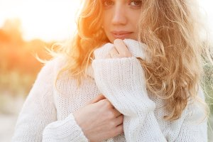 Portrait of beautiful young woman wearing white sweater