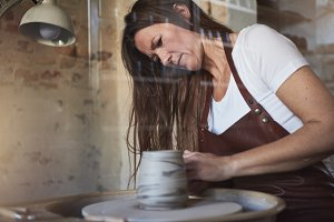 Female artisan creating a new piece in her ceramic studio