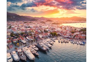 Aerial view of boats and yahts and beautiful architecture at sunset