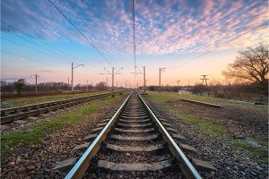 Railroad and beautiful sky at sunset. Railway