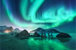 Green aurora borealis and people. Northern lights