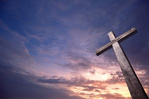 Sunrise and wooden cross