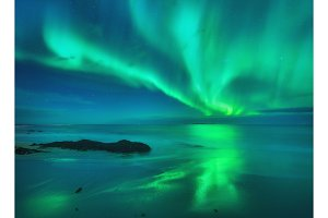 Aurora on the sea. Northern lights in Lofoten
