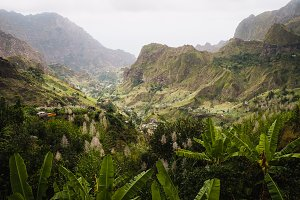 Cape Verde. Gorgeous view of famous fertile Paul Valley. Agriculture terraces of sugarcane in vertical valley sides, people dwellings, rugged peaks and motion clouds on horizon