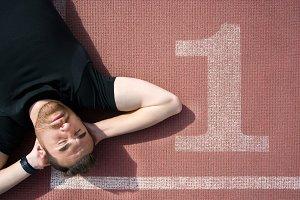 Man lying on the running track