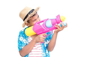 Boy playing water gun on white