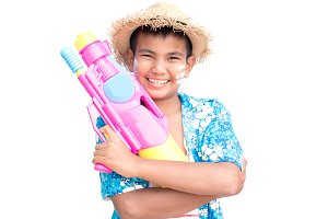 ฺBoy playing water gun on white