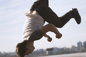 Young man jumping outdoor - sport parkour