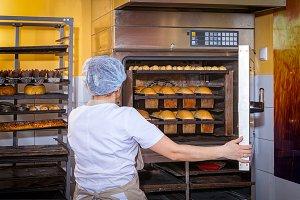 Baker bakes bread