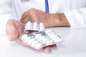 doctor showing pills in the hospital