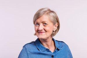 Portrait of a happy senior woman in studio.