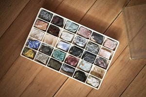 Collection of minerals in  box