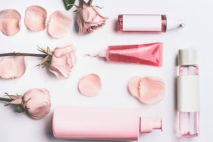 Pink cosmetic products with roses
