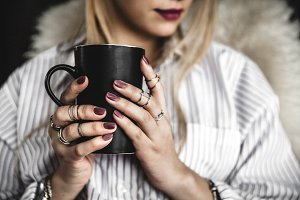 A cup of coffee, stylish manicure