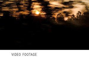 Passing landscape at sunset