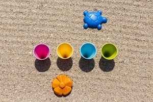 Sand and water toys on the beach.