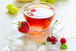Iced fruit tea with ice cubes