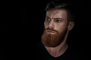 Portrait of young handsome bearded man looking forward