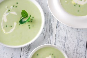 Portions of pea cream soup