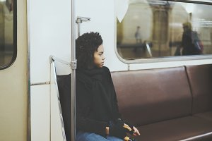 Black girl in a subway carriage