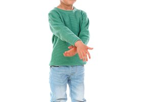Child with green t-shirt dancing