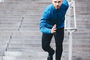Handsome sportsman running in athlet