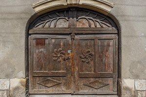 Worn closed wooden door