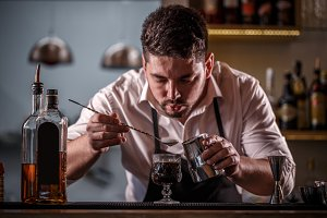 Bartender decorating coffee cocktail