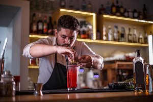 Bartender decorating cocktail