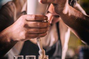 Bartender preparing short drink