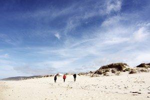 people walking in Razo beach
