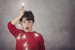 surprised boy with light bulbs