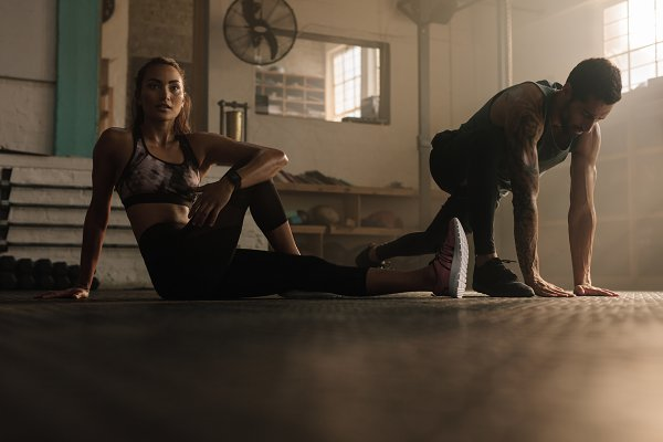 Sports Stock Photos: Jacob Lund Photography - Fitness people doing stretching