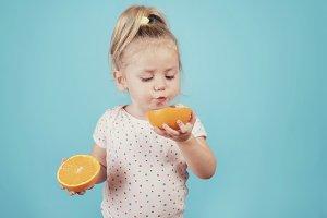 baby eating an orange