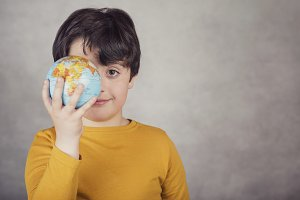 smiling boy with a earth globe