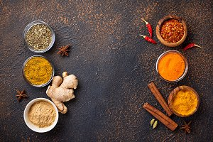 Traditional Indian spices on rusty background