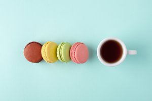 Cup of coffee with macarons